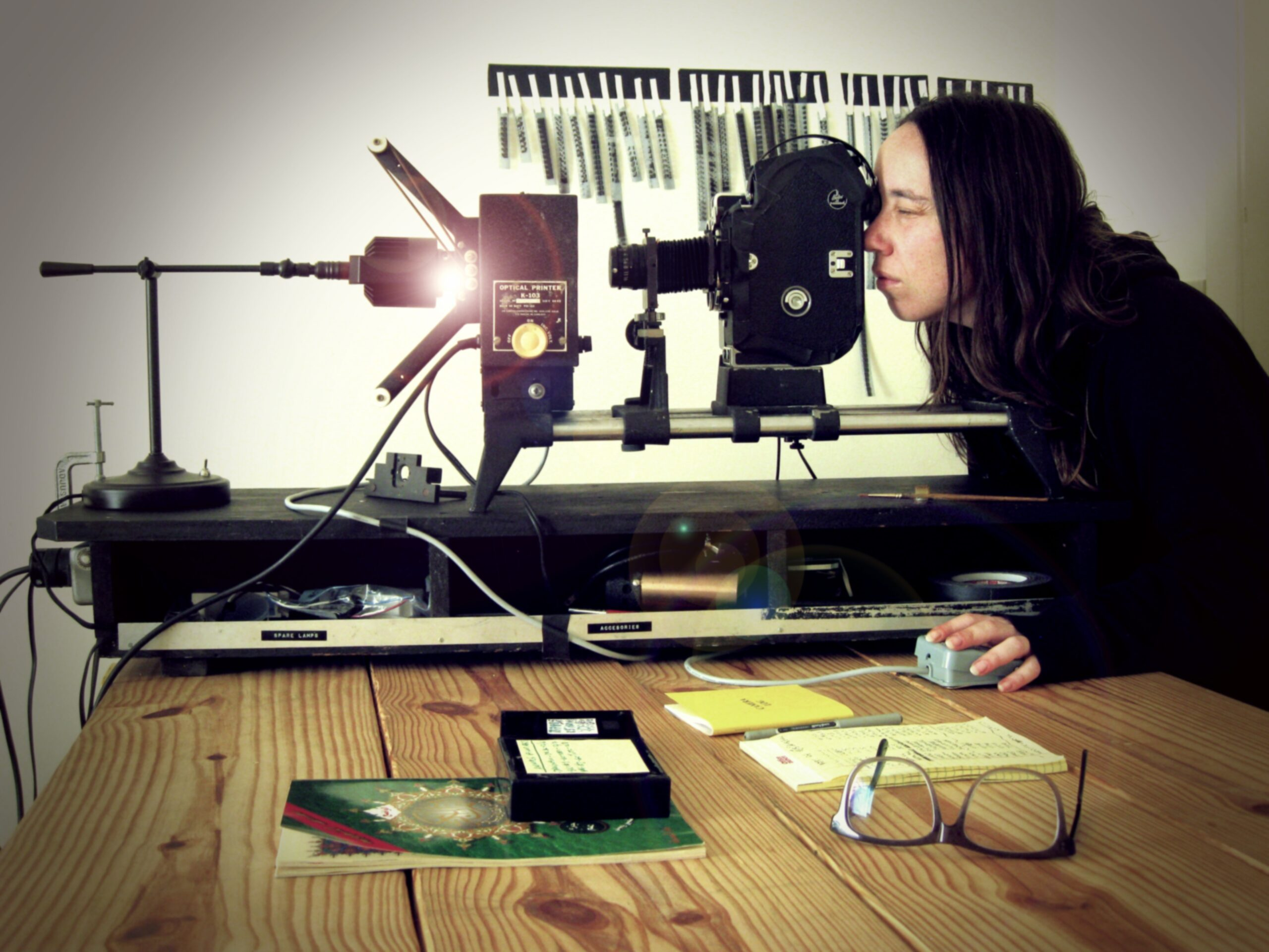 An artist uses photography processing equipment