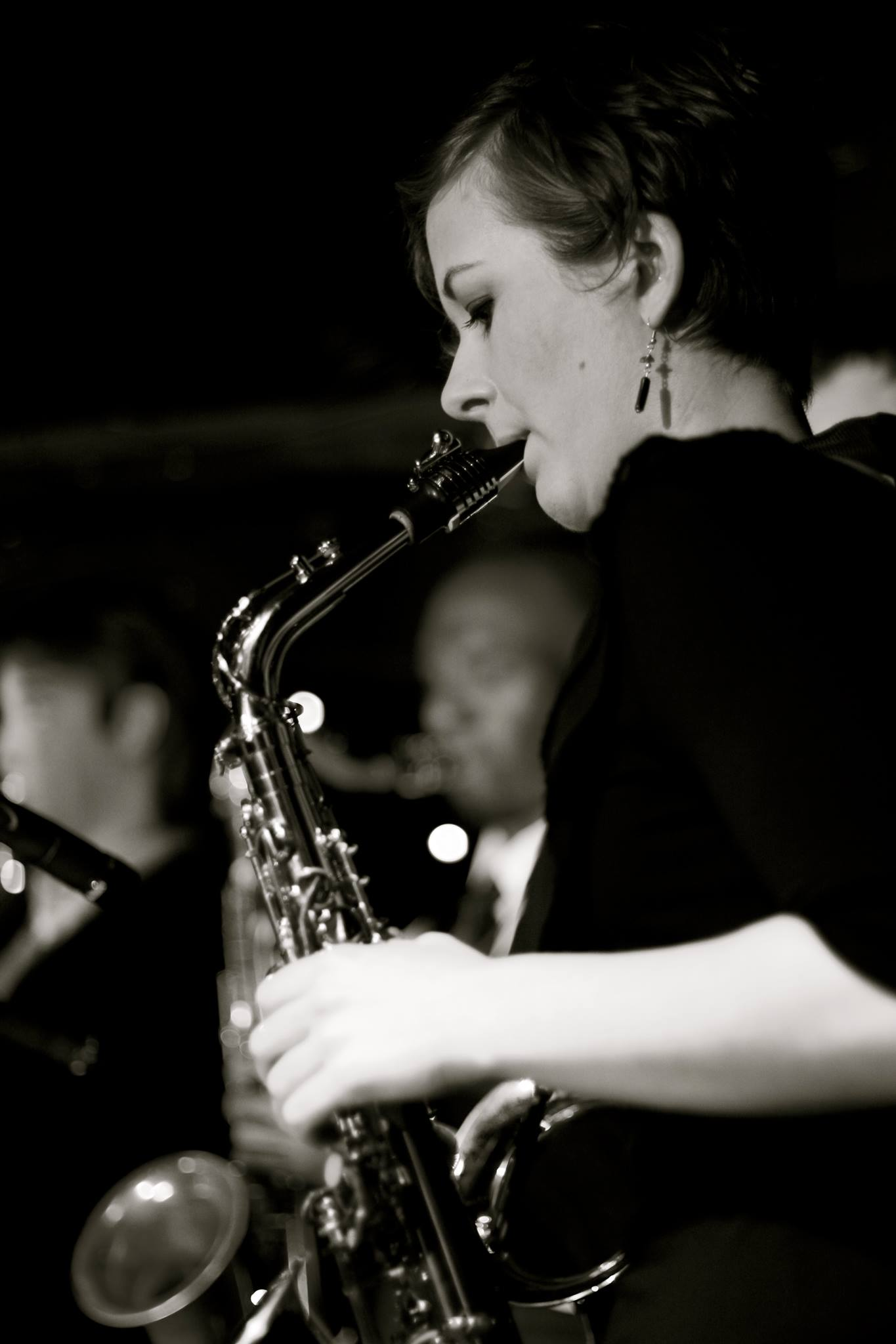 Black and white image of a woman playing a saxophone
