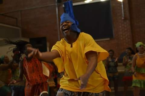 A man performs a jubilant traditional African dance