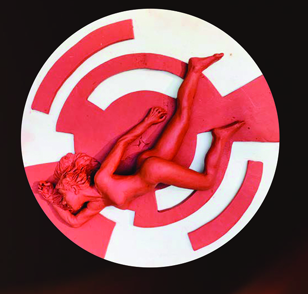 A female figure sculpted in red clay. The figure is set against a red and white circular background.