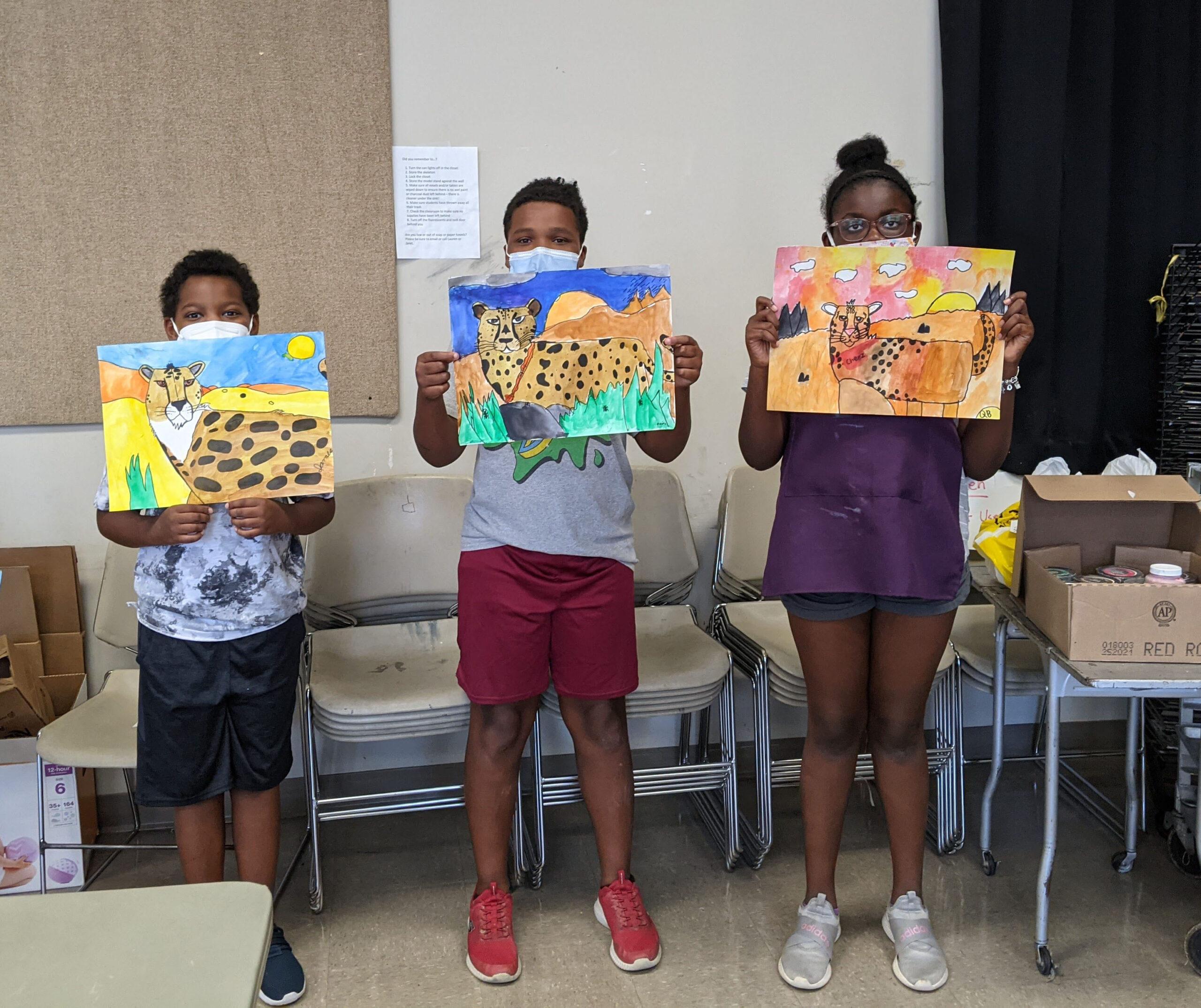 campers holding artwork